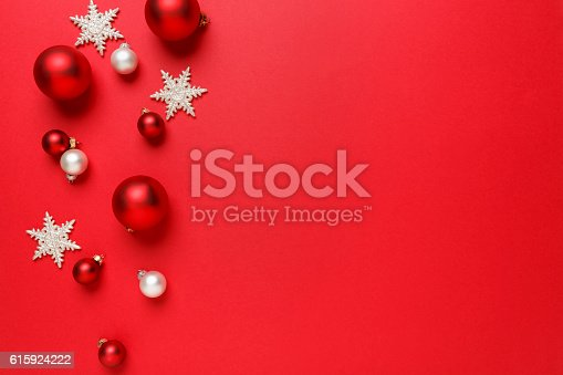 istock Christmas decorations ornaments simple classic red background horizontal border 615924222