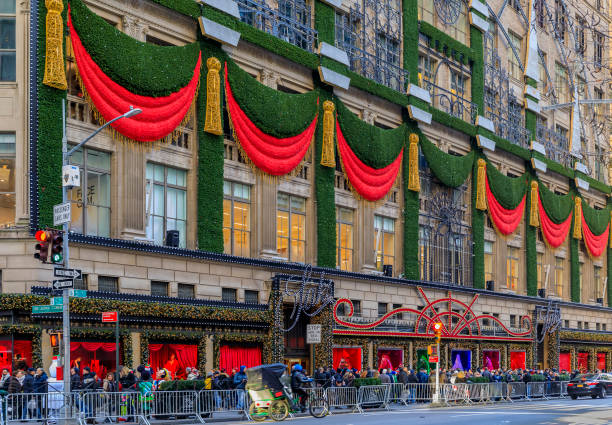 Christmas decorations red ribbons, wreaths and lights on the flagship Saks Fifth Avenue store in Manhattan New York, USA stock photo