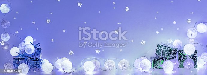 istock Christmas decorations. Round electric Christmas lights. Horizontal banner. 1048954942