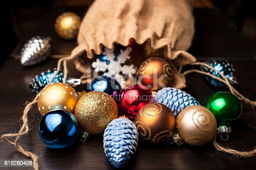 istock Christmas decorations spilled from canvas bag on a table 615260408