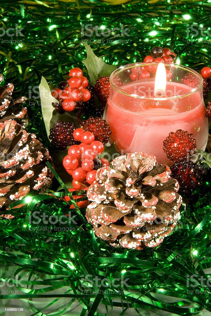 Christmas decorations with lit Candle stock photo