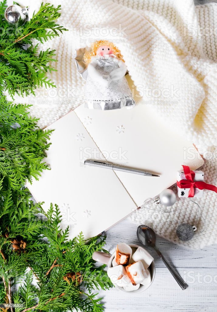 Christmas decorations.The open notebook on the wooden table royalty-free stock photo