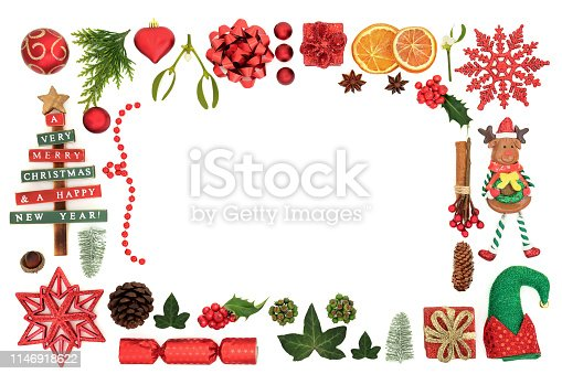 Christmas decorative background border with festive tree bauble decorations, winter fora, food and symbols on white background with copy space.