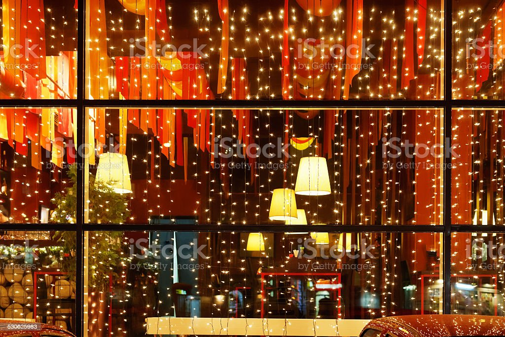 Christmas decorative lights of restaurant window stock photo