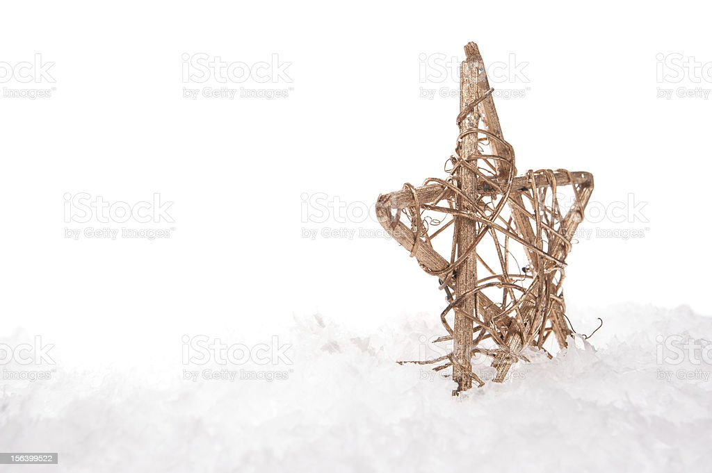 Christmas decorative star on the snow royalty-free stock photo