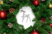 istock Christmas deer or moose with fir branches and new year toy ball, cones 1071661302