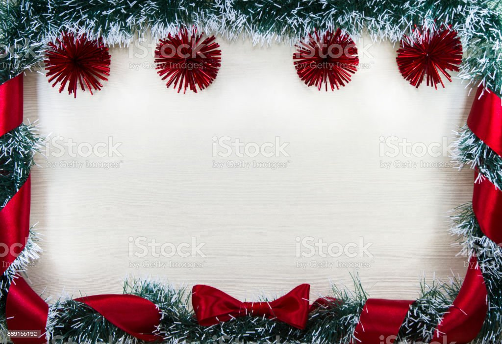Christmas design-Christmas card bordered by pine and red balls and ribbon with bow, place for text. stock photo