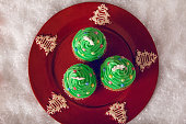 Christmas Tree Cupcakes On Decorated Plate. View From Above