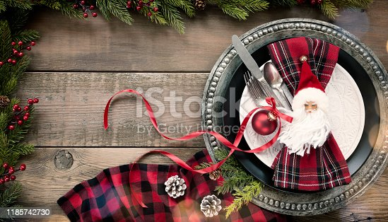 Holiday Christmas Dining Plate and Napkin on an Old Wood Table. Menu concept.