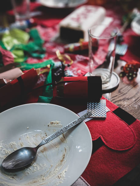 Christmas dinner after the party. Messy table. Dark vintage. stock photo