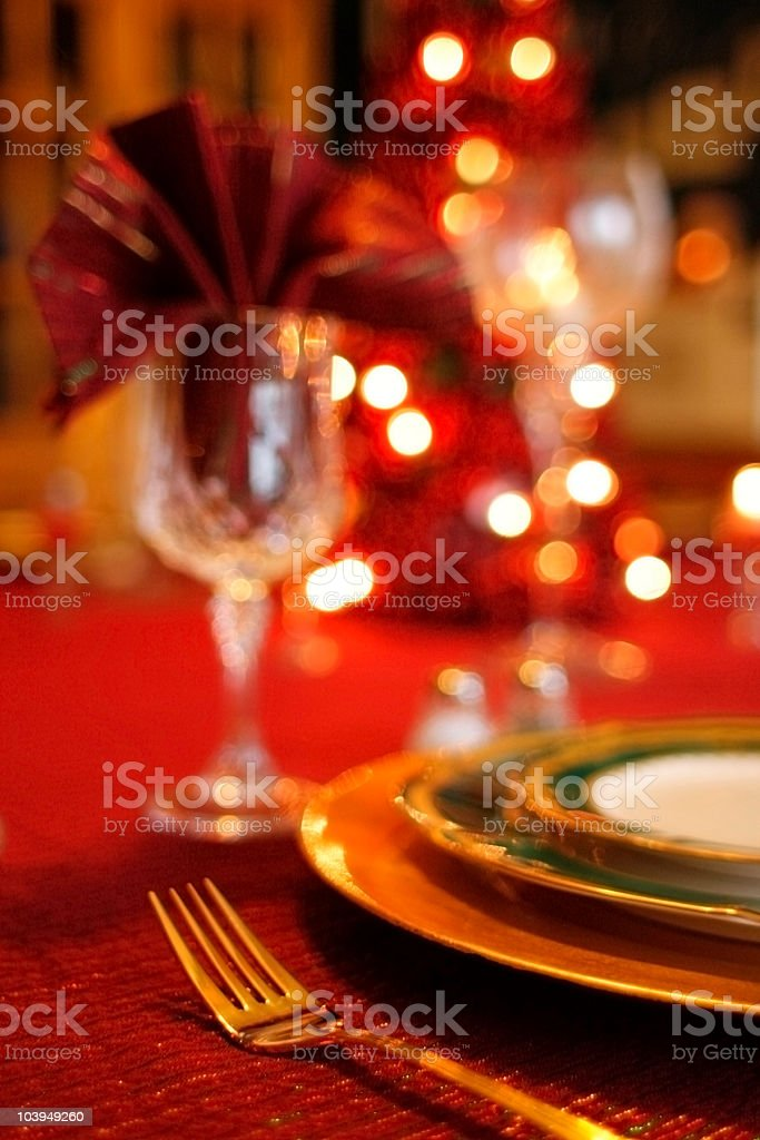 Christmas Dinner: Golden Table Setting With Defocused Lights royalty-free stock photo