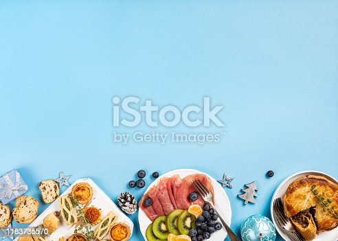 1064325668istockphoto Christmas dinner party table 1183735570