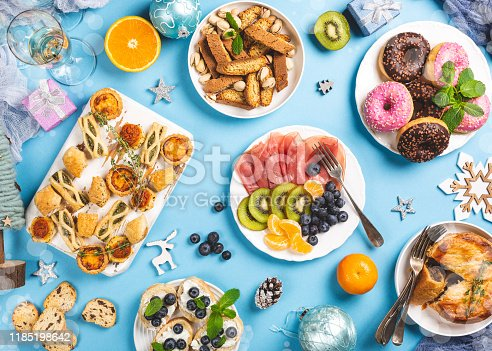 1064325668istockphoto Christmas dinner party table 1185198642
