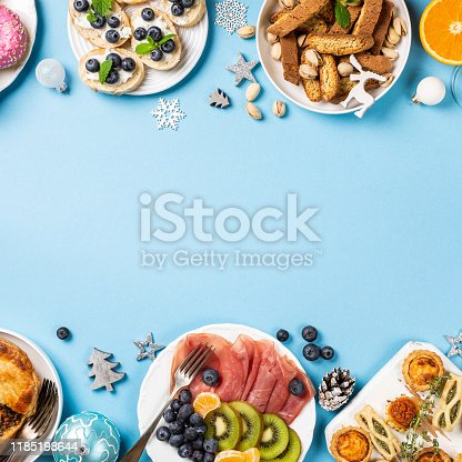 1064325668 istock photo Christmas dinner party table 1185198644