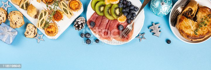 1064325668istockphoto Christmas dinner party table 1185198645
