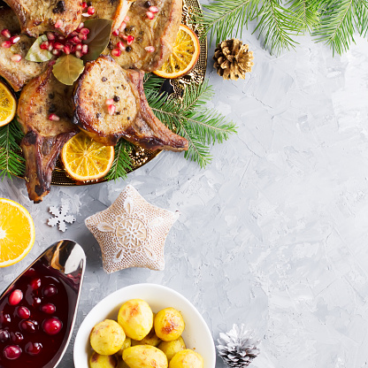 istock Christmas dinner with roasted meat steak, Christmas Wreath salad, baked potato, grilled vegetables, cranberry sauce. 1079697990