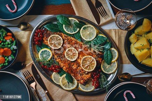 Christmas Dinner with Salmon Fish Fillet, Prepared Potato, Carrots, Peas, Polenta and Christmas Cake