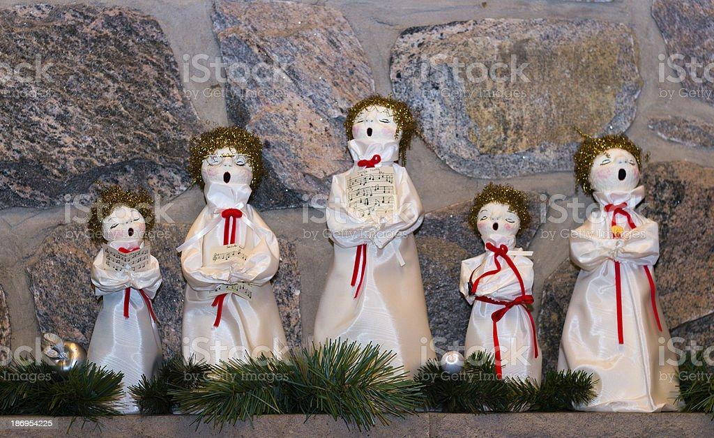 Christmas dolls singing carols stock photo
