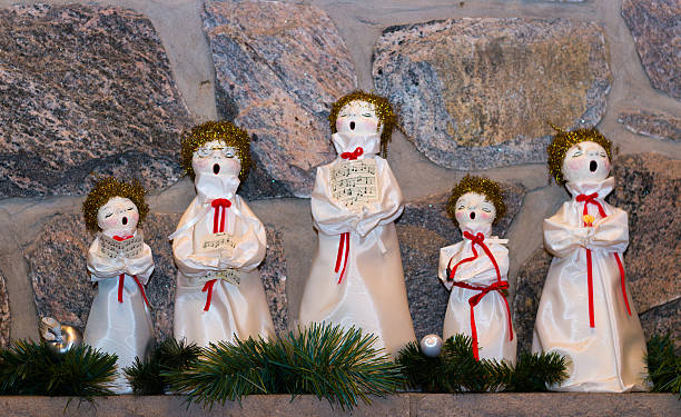 Christmas dolls singing carols stock photo