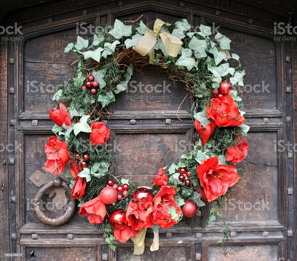 A traditional Christmas wreath door decoration with Ivy and Amaryllis...