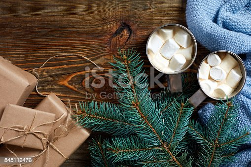 istock Christmas drink. Mug hot coffee with marshmallow on the wooden background. New Year 845116476