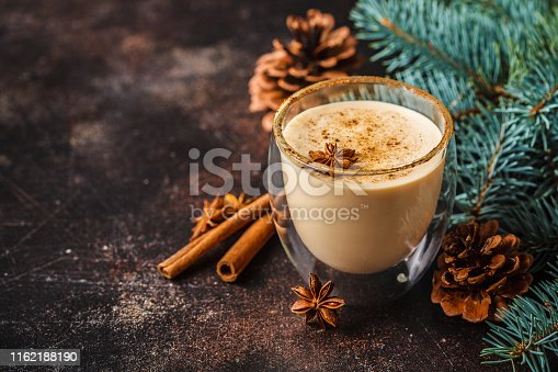 Christmas eggnog in a glass in a Christmas background.