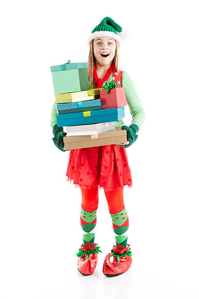 christmas elf carries a big stack of wrapped present - pixie dust bildbanksfoton och bilder