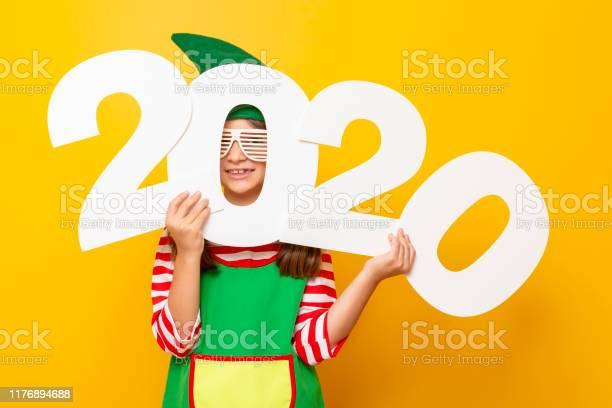 Christmas elf holding 2020 numbers