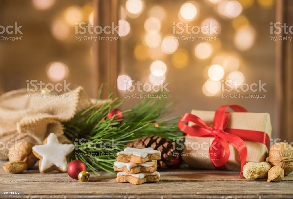 Christmas eve gift with decoration and festive lights background Christmas present and santa bag decoration with sparkling lights background. Advent Stock Photo