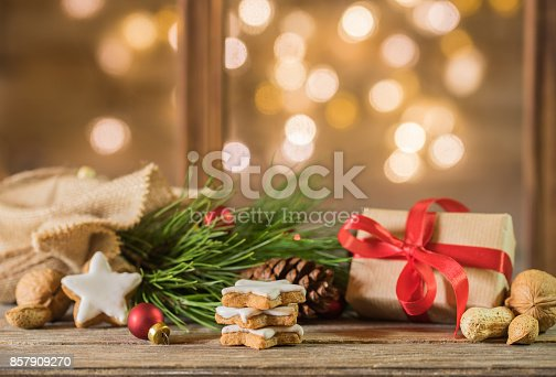 istock Christmas eve gift with decoration and festive lights background 857909270
