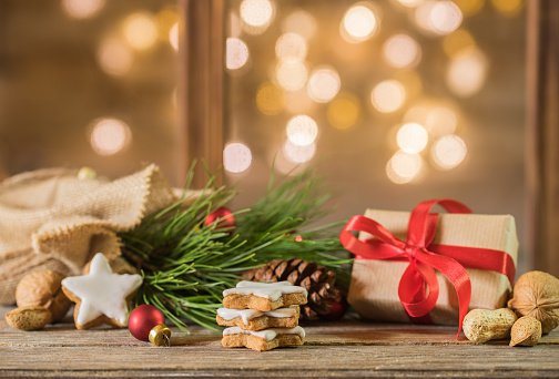 Christmas Eve Gift With Decoration And Festive Lights Background Stock Photo - Download Image Now