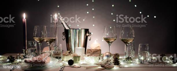 Christmas eve party table with white wine glass and glitter seasons picture id1073241730?b=1&k=6&m=1073241730&s=612x612&h=hksak2vbjxxgyop2vnkellygxmez yxkhnsixg30a3o=