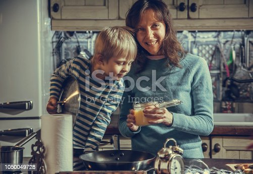 Christmas Eve. mom and son are drinking tea