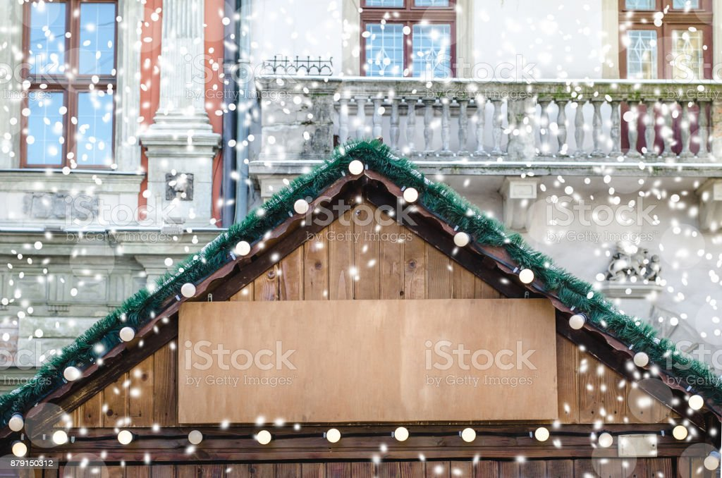 Christmas fair drawing snowfall toned part of wooden houses