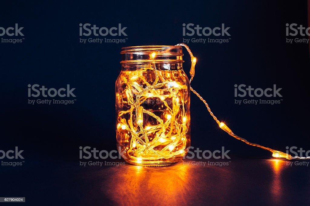 Christmas fairy lights in a mason jar stock photo
