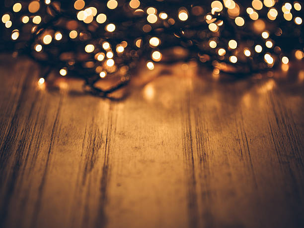 Christmas Fairy Lights On A Wooden Table Stock Photo