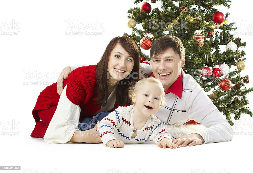Christmas family and fir tree royalty-free stock photo