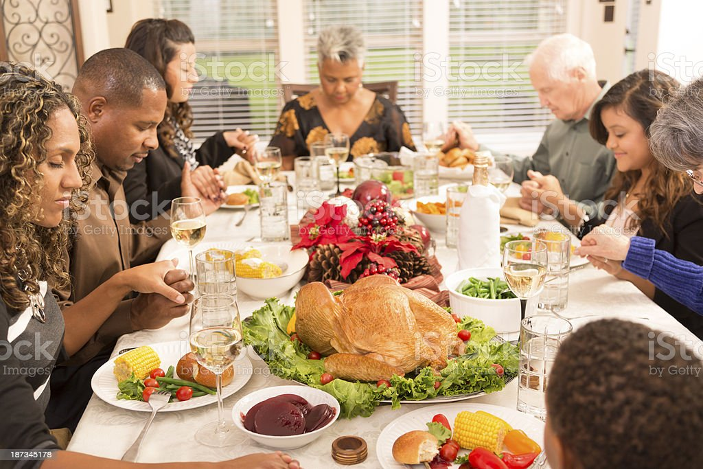 Christmas Family And Friends Pray Before Eating Dinner