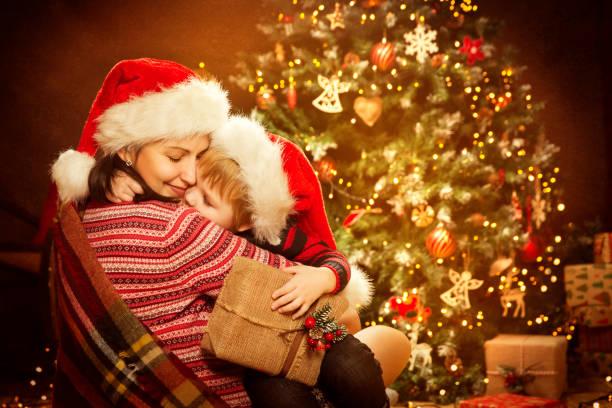 Christmas family and xmas tree mother give child new year present picture id1063239774?b=1&k=6&m=1063239774&s=612x612&w=0&h=pdopyjuruet762bnmvuvieiw4yrgvs9yxjdd0ixbvrs=