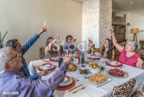 1035768506 istock photo Christmas family celebration 863244826