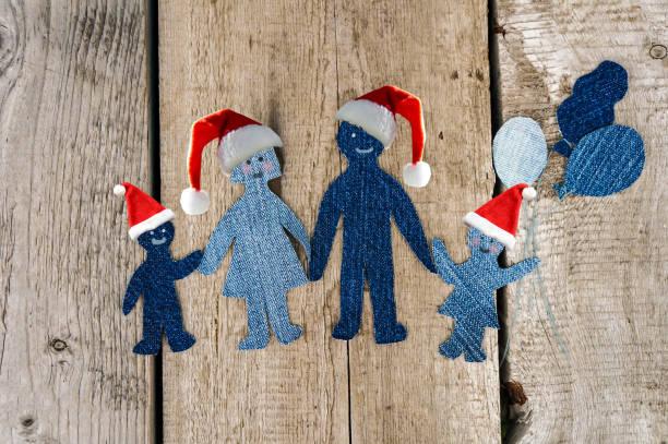 Natal. Família. Happiness.Happy família vestindo chapéus de Papai Noel - foto de acervo