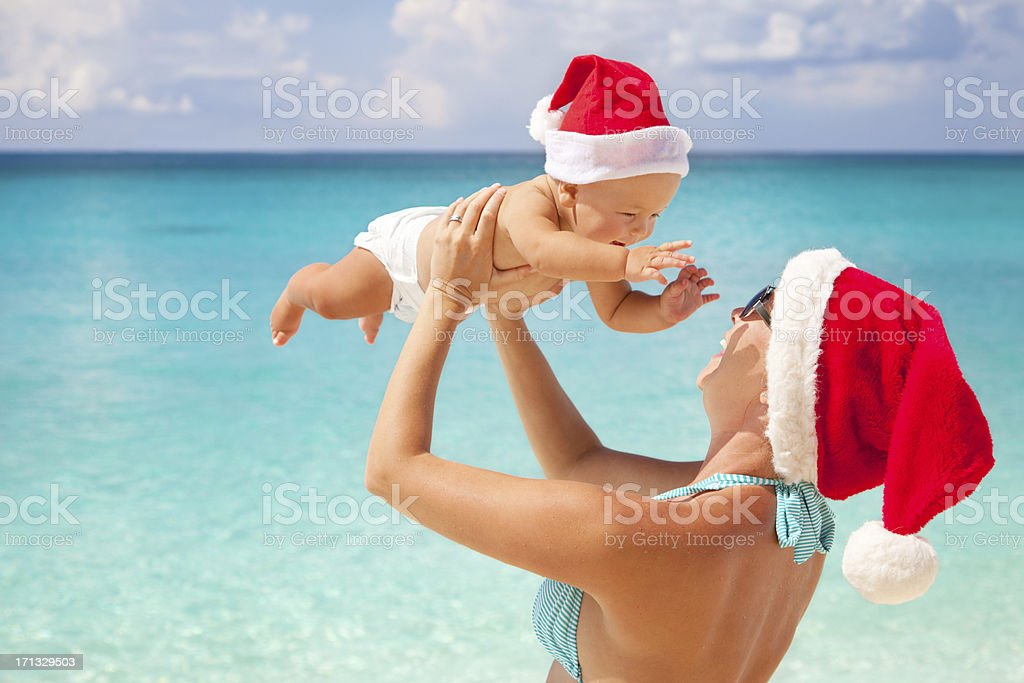 Christmas family - mother and child playing at a beach royalty-free stock photo