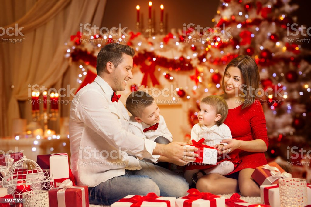Christmas family portrait decorated xmas tree happy children and present gift box stock photo