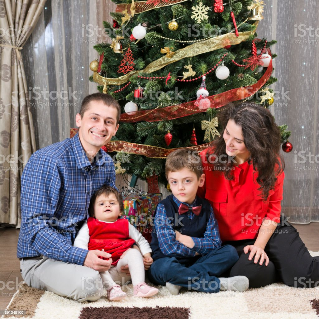 Christmas Family Portraits.Christmas Family Portrait Looking Light Christmas Tree Stock Photo Download Image Now