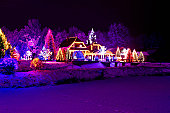 Christmas fantasy - park, forest, pine tree & lodge in xmas lights