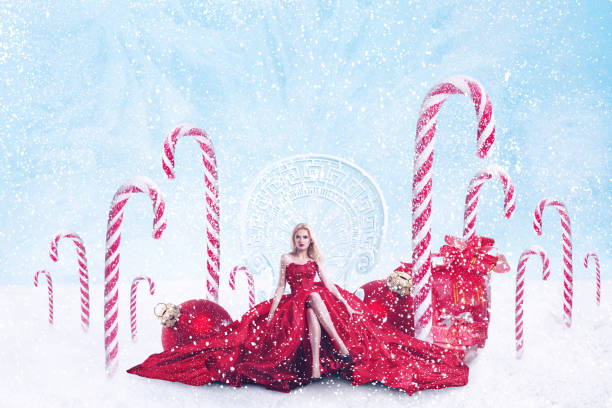 Christmas fantasy portrait of young woman with gift boxes