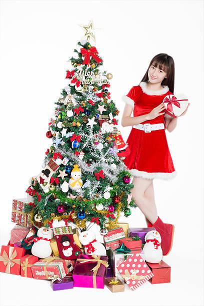 weihnachten weibliche santa - wickelkleid lang stock-fotos und bilder
