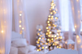 Cozy Christmas home interior. New year decoration. Blur, boke background.