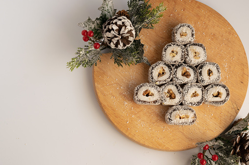 Christmas festive sweets with seasons decorations on white background