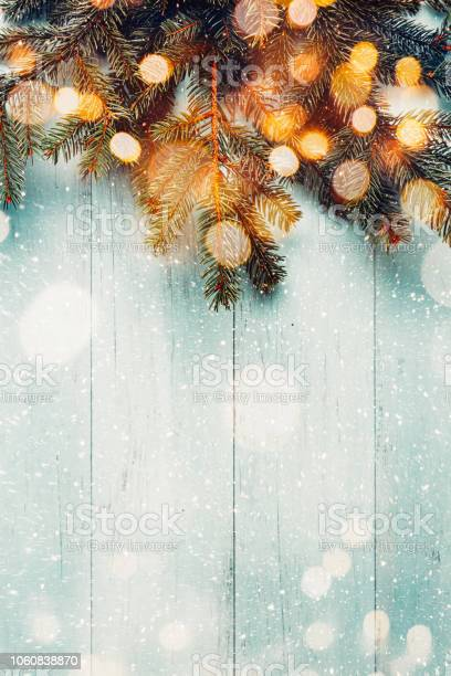 Christmas fir branches with lights on wooden planks picture id1060838870?b=1&k=6&m=1060838870&s=612x612&h=s67kbivghahkww6kdsm2jwzmnnvy87k4vz2acxi n68=